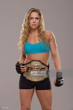 Women's Bantamweight Champion Ronda Rousey poses for a portrait during a UFC photo session on December 26, 2013 in Las Vegas, Nevada.