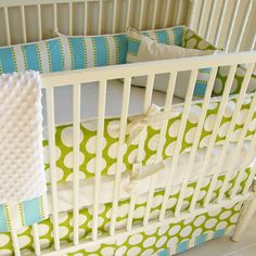 This is a little pricey, but I love the colors. Bubble Bliss Crib baby bedding.. $350.00, via Etsy. make it myself...for a boy:)