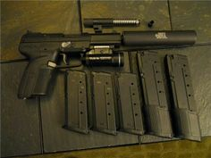 FN Herstal Five-seveN. Threaded and standard barrels, suppressor, 3 20rd stock mags, 2 30rd extended mags, StreamLight tactical flashlight.