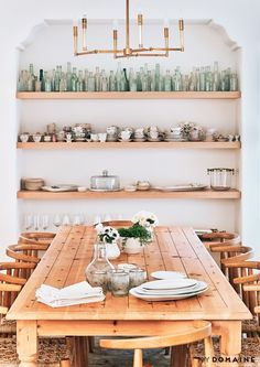 Open shelving accent wall with vintage bottles and tea cup collection. Tour Lauren Conrad's Elegant, Light-Filled Home in the Pacific Palisades | MyDomaine