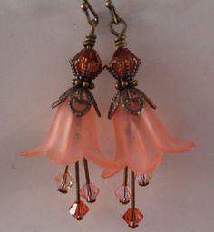 Lucite flowers, Swarovski Crystals, Antique Brass EarringsFrom simplysarahbeads