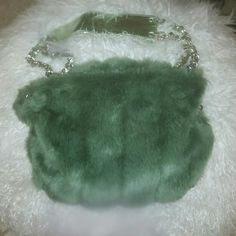 Faux fur party bag Green faux fur. Metallic green faux leather handle. Adjustable metal straps. Wear and tear on faux leather weaving and magnetic clasp. fashion express Bags Shoulder Bags