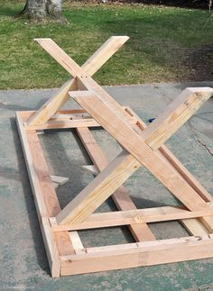 Build This DIY Outdoor Table Featuring A Herringbone Top And X Brace Legs!  Would Also