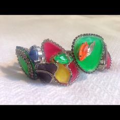 "NWOT Erickson Beamon Color Me Crazy Bracelet NWOT Erickson Beamon Color Me Crazy Bracelet Sterling Silver Swarovski $700.  Absolutely fabulous bracelet/cuff from Erickson Beamon's Color Me Crazy line - super fun neon colors with crystal accents.  Retailed for over $700!!  Never worn!! Sterling silver vermeil ~ 1.5"" in width, 2.5"" in diameter Made in the USA Thanks for looking!! Erickson Beamon Jewelry Bracelets"