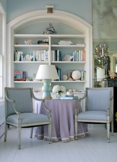 Pale blue & white -- like the two matching armchairs -- this room is very restful