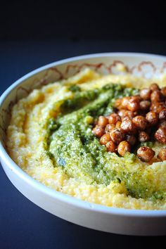 Creamy, savory and comforting, goat cheese polenta is the perfect vegetarian dinner for one. Top with basil almond pesto and fried chickpeas for crunch!