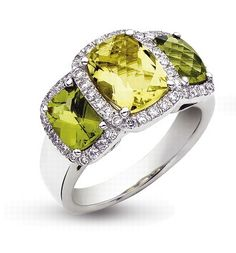 'Eternal' Three Stone Peridot, Lemon Quartz & Diamond Ring    The zesty combination of vibrant green peridot and lemon quartz adds a zing of colour all year round. The cushion cut central lemon quartz has two peridots either side, surrounded by dazzling diamonds set in 18ct white gold.