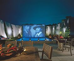 Backyard with pool, lighting, chairs and table...and oh yeah Casablanca. This is gorgeous.