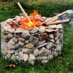Fire pit idea. With as many rocks of various sizes we have, this would be a great idea & help clean up our yard!