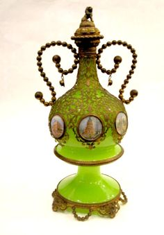 A Stunning Tall French 19th Century green opaline glass scent bottle with 6 hand-painted miniatures of Paris and fancy dore bronze mounts.