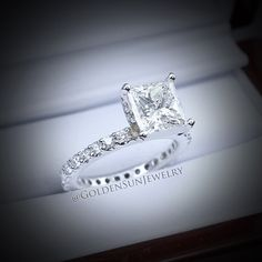 Simply beautiful. 3.02ct. Princess cut on an elegant eternity band.