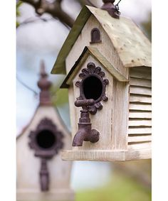 Use a faucet and door hardware to decorate a birdhouse. Perfect repurposed junk!