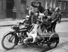 November 1923: Nancy Debenham giving a group of children a ride on her motorcycle (a 1923 Douglas). (Photo by Topical Press Agency/Getty Images)  Credit: Topical Press Agency / stringer