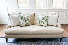 Neutral sofa + patterned pillows: http://www.stylemepretty.com/living/2016/05/10/master-the-perfect-touch-of-gold-like-this-design-pro/   Photography: Lindsay Salazar Photography - http://www.lindsaysalazar.com/
