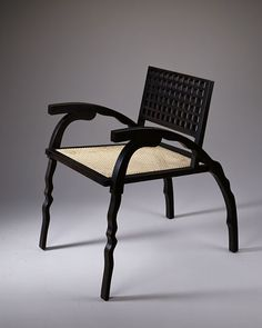 Sylvia's Chair by Garry Knox Bennett. Lacquered wood and hand-caned seat.