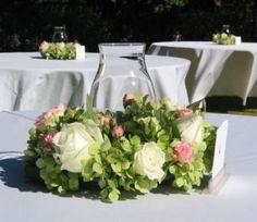 Green hydrangeas & pink roses with hurricane