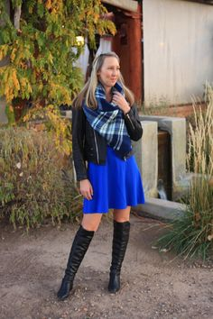 fall winter outfit ideas leather jacket flared cotton dress over the knee boots plaid blanket scarf