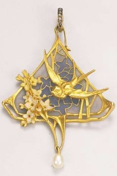 AN ART NOUVEAU ENAMEL AND GOLD PENDANT, BY LEOPOLD GAUTRAIT, CIRCA 1900. Of triangular form, depicting a swallow aloft a bouquet of flowers, against a background of plique-à-jour enamel, suspending a pear-shaped pearl, mounted in yellow gold. Signed L. Gautrait. #LeopoldGautrait #ArtNouveau #pendant