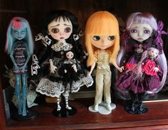 Group photo for size.  Left to right.  Monster high ice cam repaint, Wednesday Addams(dressed up on a Wednesday), Mango Blythe, and Violetta Crackle