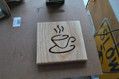 Steaming coffee hot plate. I used my scrollsaw to cut in the pattern onto a strip of oak wood.