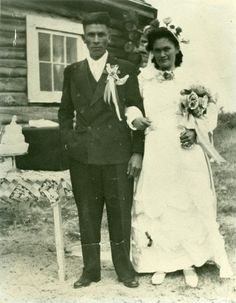 wedding photo, late 1940's. what is lurking in the window behind them?.