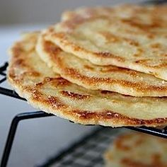 This gluten free naan bread is made extra soft and tender with yogurt, eggs and butter or ghee in the dough. Make the dough ahead, and fry it in minutes! Gluten Free Pita Bread, Gluten Free Treats, Gluten Free Baking, Vegan Gluten Free, Dairy Free, Foods With Gluten, Sans Gluten, Soft Flatbread Recipe, Naan Recipe