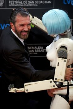 Antonio Banderas posed with a mock robot featured in his movie Automata at the San Sebastian International Film Festival in Spain on Sunday.
