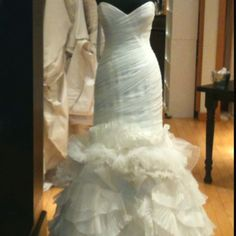 Another beauty. Love the detail on the pleats