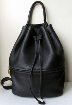This is close to what my bag looks like. Surprise! It's black. Mine was picked up from my neighborhood Thrift Town so I don't know anything about it except how much I love it.