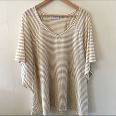 Gold Striped Tee 3x So cute with dark blue or red chinos! Contrasting stripes and in great condition worn maybe once or twice. Slight dolman sleeve. No trades no PayPal marked 26/28 fits like a 3x in my opinion Avenue Tops Tees - Short Sleeve