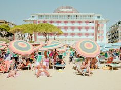 Vistamar by Mario Dotti | iGNANT.de | The series 'Vistamar' or 'sea view' when translated from Italian by Milano based photographer Mario Dotti offers views of a beach of sunburnt holidaymakers in a 'perfect world' beach resort. The slightly over-exposed look adds to the feeling of bright sunlight and his pastel-coloured pictures present an idealised image with powder-blue parasols, pink hotels, yellow sun loungers, reddened bodies and bored looks.