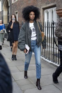 Julia Sarr Jamois wears a graphic t-shirt, bomber jacket, cropped jeans, and black boots