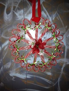 I've seen a few ideas for candy cane wreaths, but this version matches my color theme perfectly!