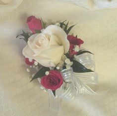 Corsage with white rose and dark pink spray roses from Floral Fashions