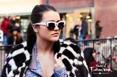 We love how these two-tone frames work back perfectly with the fur. London Fashion Week. #ShadesOfFashionWeek #lfw #sunglasses