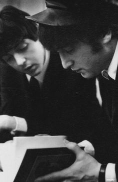 John and Paul read John's first book 'In His Own Write', 1964