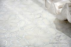 Stella, a stone mosaic and glass waterjet mosaic in honed Afyon White, tumbled Thassos, and Shell | Designed by Sara Baldwin Designs for New Ravenna