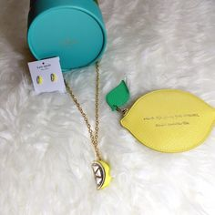 """Kate Spade Lemon Necklace Kate Spade lemon pendant. Shiny 12 karat gold plated metal with enamel fill. Epoxy stones and glass stones. Lobster claw clasp. Pendant drop 1.7"""". 32"""" length necklace. Lemon yellow. This listing is for necklace only. 72. Comes with dust bag. kate spade Jewelry Necklaces"""