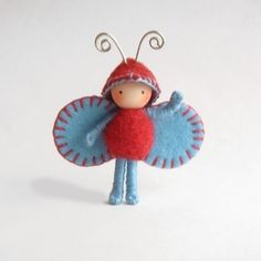 This is a sweet 1 1/2 inch Cherries and Blueberries Juicy Bug. It is made of wire covered in cotton floss. It has a wood bead head and wire antenna. It's belly is made of needle felted wool. The wings and hat are made of wool felt.  $14 on | http://toyspark.blogspot.com