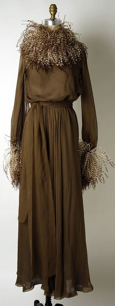 Evening dress  Yves Saint Laurent, Paris  (French, founded 1962)  Designer: Yves Saint Laurent (French (born Algeria) Oran 1936–2008 Paris) Date: 1974–75 Culture: French Medium: silk, feathers