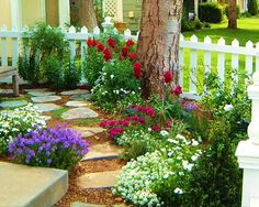 Flower Garden. So pretty with the stones...