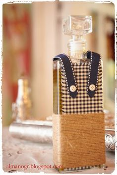 Bottle for olive oil decorated with natural cord, checks fabric and ribbon - Μπουκάλι λαδιού στολισμένο με σπάγγο, ύφασμα και κορδέλα #bottle #christeningbottle #handmadedecor #almanogr #μπουκαλιλαδιου Bottles And Jars, Perfume Bottles, Projects To Try, Decoration, Mothers, Decor, Perfume Bottle, Decorating, Decorations