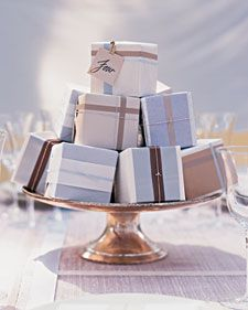 centerpieces that feature little wrapped favors displayed on a pedestal...practical and great looking!