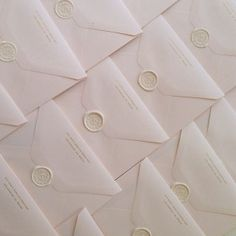 FOR THE STATIONARY || White wax seals on white envelopes || NOVELA BRIDE...where the modern romantics play & plan the most stylish weddings... www.novelabride.com #jointheclique @novelabride