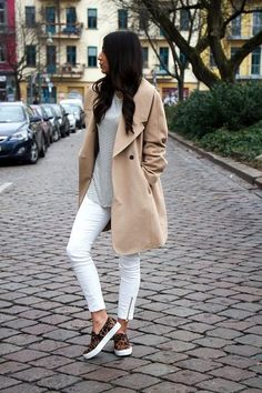 Beige raincoat over striped top and white jeans with leopard print shoes.