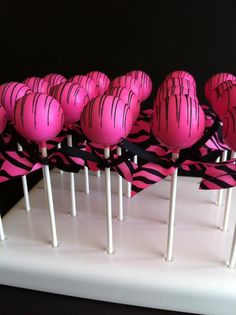 Cake Pops- in pink and black!!! Love!  Change to purple & black for Beiber party.