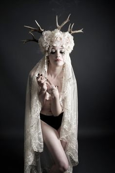Rock and roll bride with antler headpiece and antique veil from www.glorydaysvintage.co.uk