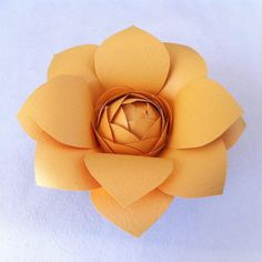 Make this beautiful paper flower using any craft paper you like. Make them as centerpiece for your home, a wedding, or party decor.    Materials   paper plastic egg scissors glue