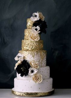 Add black silk roses and anemones to your gold wedding cake. Afloral.com's silk flowers will help you create your luxe wedding for less. Pinned by Afloral.com from http://mavenbride.com/create-a-wedding-brand/