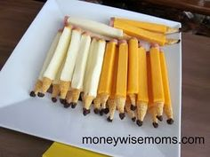 "Back to School snack- ""PENCILS""  Made with:  Mozarella or Colby String Cheese sticks  1/2 inch-thick slices of bologna  Mustard  Bugles Corn Snacks  Raisins"